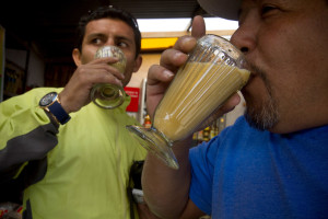 People drink a maca-based drink at a small roadside restaurant in Carhuamayo